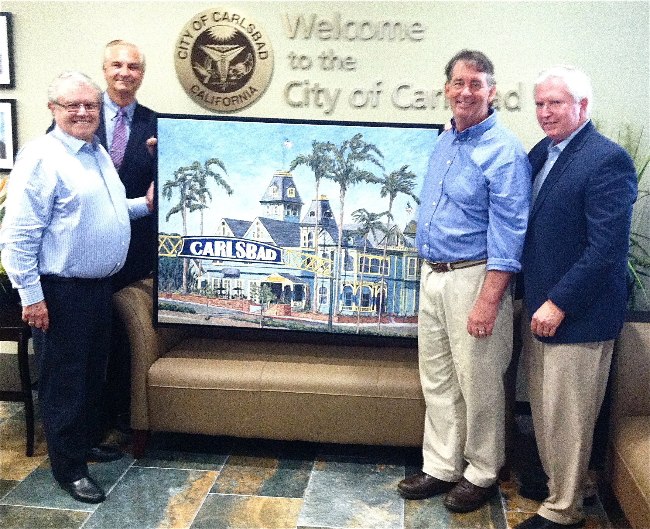 At Carlsbad City Hall: Mayor Matt Hall, Carlton Lund, Leigh, and Craig Lindholm
